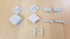 Set příslušenství - koncovky, rohy, kouty  pro  VO62 hliník/inox světle šedé